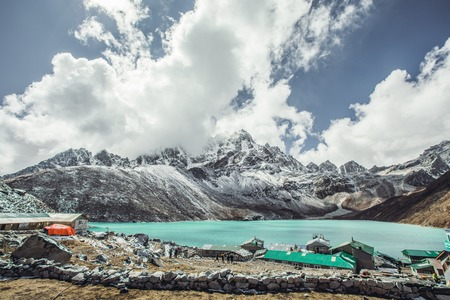 Valley of Himalayan mountains with mountain lake on track to Everest base camp. High mountains with snow-capped peaks. Khumbu valley, Sagarmatha national park of Nepal. Stock Photo