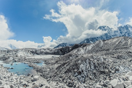 Glacier with snow mountain peaks. Panoramic view of Himalaya mountain.