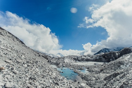 Glacier with snow mountain peaks. Panoramic view of Himalaya mountain. Way to Everest base camp, Khumbu valley, Sagarmatha national park.