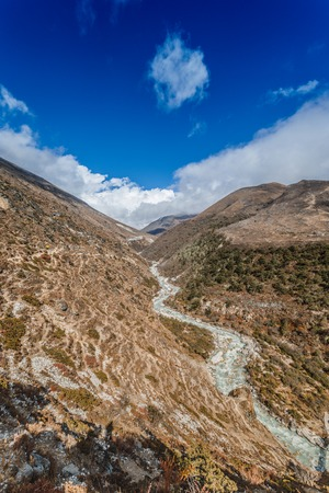 Himalayan landscape with mountains, forest and a mountain river on trek on Everest base camp Stock Photo - 90613066