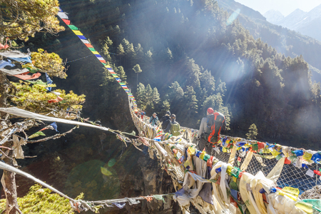 Famous suspension bridge on the way to the base camp of Everest, the Himalayas, Nepal.