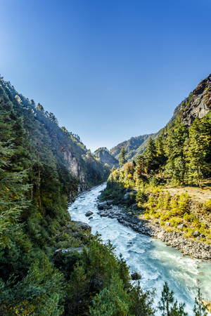 Himalayan landscape with mountains, forest and a mountain river on trek on Everest base camp
