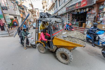 KATHMANDU/NEPAL - NOVEMBER 14, 2017: Shopping street with colorful decorations in Thamel district of Kathmandu, Nepal