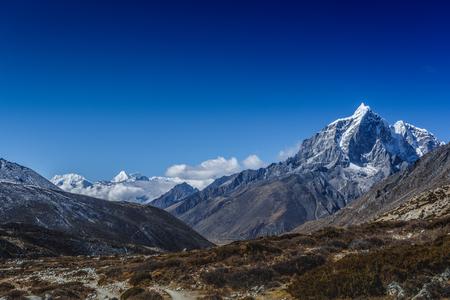 Snow mountain peaks on Ama Dablam. Panoramic view of Himalaya mountain. Way to Everest base camp, Khumbu valley, Sagarmatha national park.