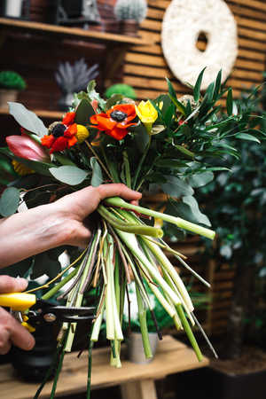 Professional florists making flowers bouquets in a flower shop Stock Photo
