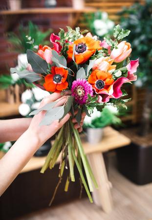 Florist arrangement a flowers bouquet at his workplace Stock Photo