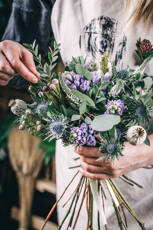 Own small business concept with woman florist working in modern flower shop Stok Fotoğraf - 96101899