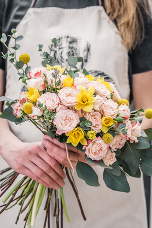 Professional crop artist showing tender blooming bunch of flowers.  Stock Photo