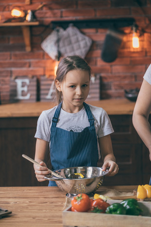 Girl standing with bowl of salad