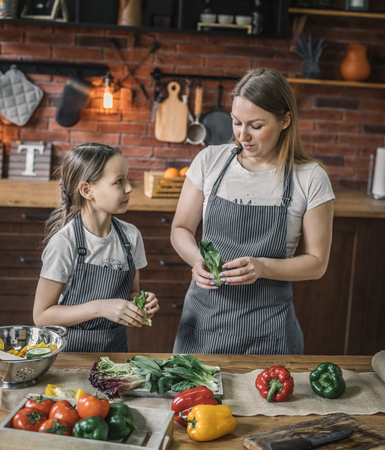 Mother and daughter preparing herbs