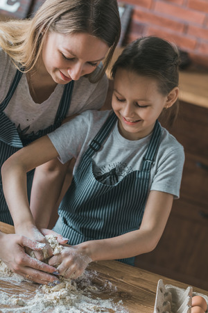 Happy mother and child making dough Stock Photo