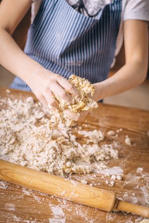 Crop girl making dough