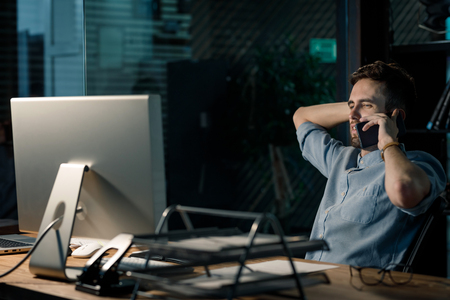 Exhausted worker with phone in office