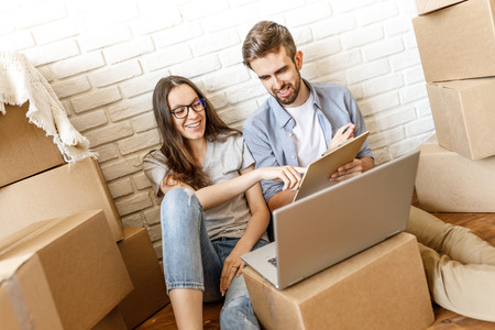 Smiling couple preparing for moving Stock Photo