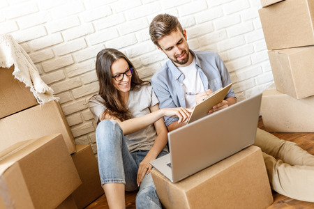 Couple doing to do list before moving