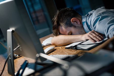 Sleeping man overworking in office Stock Photo