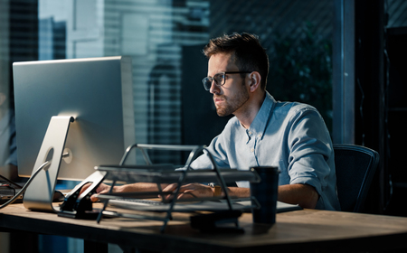 Man working late at night in office