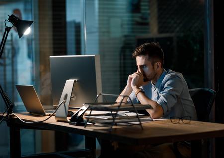 Tired man focusing on work