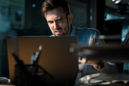 Man having error in computer while working