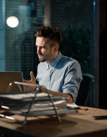 Man having problems with gadget at work