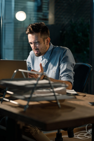 Man irritated with mistake in laptop