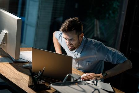 Screaming man with broken laptop Stock Photo