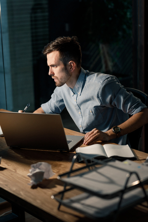 Hardworking man late at night in office