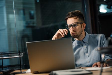Man focusing on work with laptop