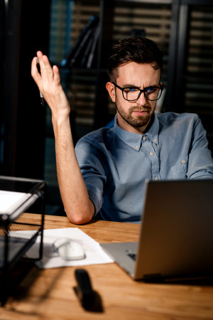 Confused man having problems at work