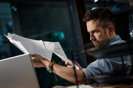 Smart man concentrated on work with laptop