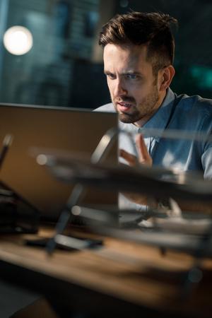 Employee irritated with laptop work Stock Photo