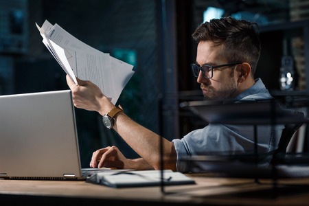 Casual man working on laptop in office Stock Photo