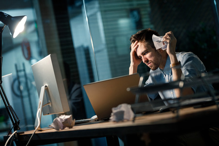 Upset man having troubles with inspiration