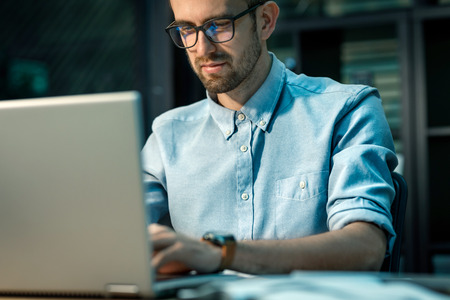 Relaxed man working on laptop Stock Photo