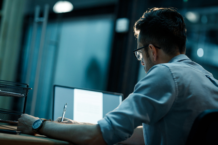 Man in office working late Stock Photo