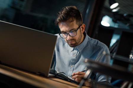 Focused employee taking notes Stock Photo