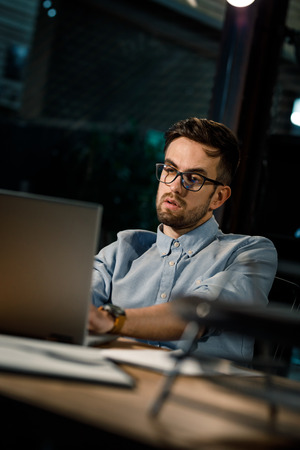 Exhausted office worker at table