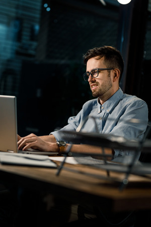 Confident worker with laptop