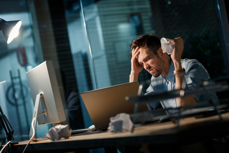 Irritated man working in office