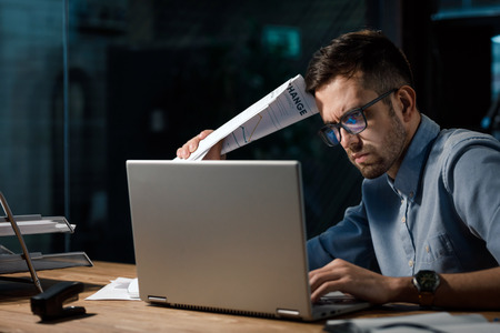 Working late man in office