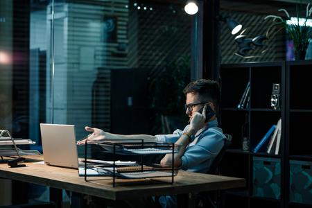 Working man speaking on phone Stock Photo