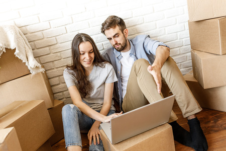 Young couple surfing laptop while moving Standard-Bild - 103662615