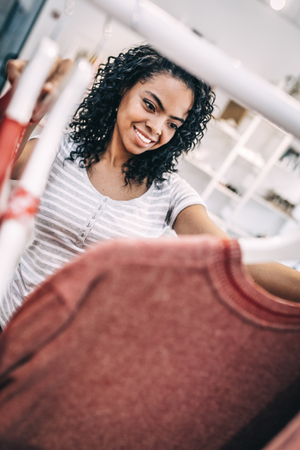 Relaxed woman shopping in clothes store
