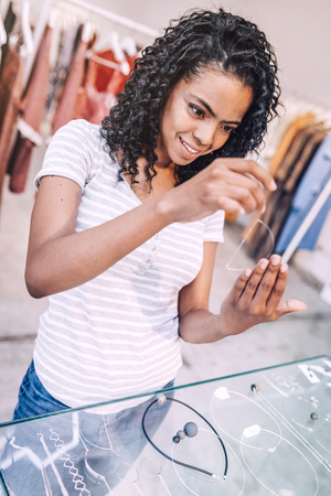 Content woman buying jewelry Stock Photo