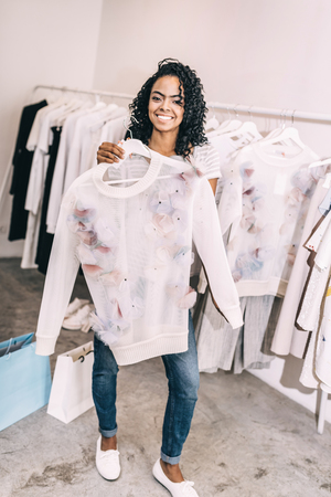 Black woman in shop with shirt