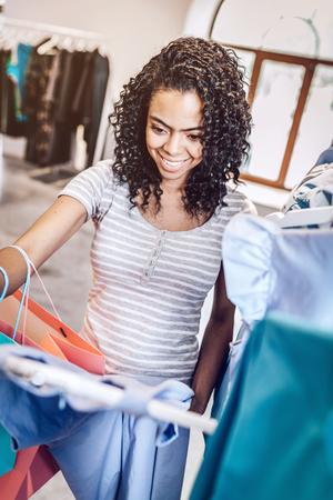 Pretty woman choosing new clothes
