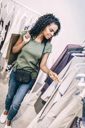 Relaxed woman shopping in leisure Stock Photo