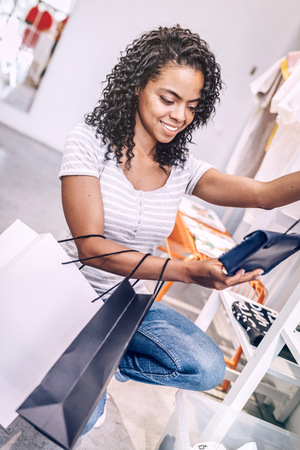 Smiling woman buying new clutch
