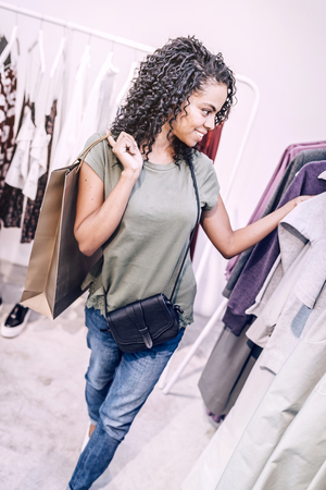 Charming black woman shopping in store