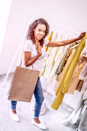 Charming black woman with dress in shop Stock Photo
